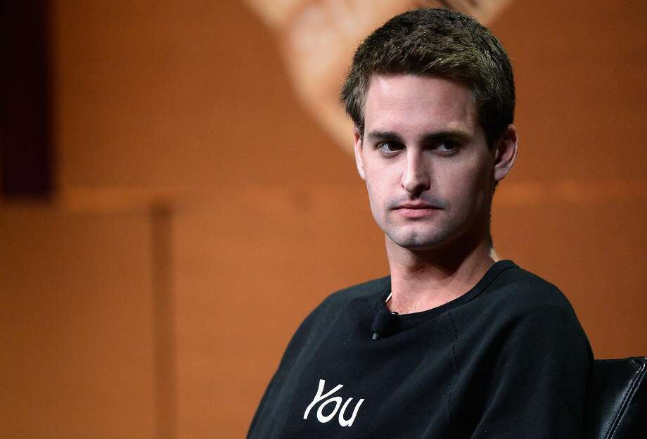 "Snapchat CEO Evan Spiegel speaks onstage during "" isrupting Information and Communication"" at the Vanity Fair New Establishment Summit in San Francisco in October 2014. After Snap goes public, he is expected to be worth billions of dollars and largely control the company's direction. Photo: Michael Kovac, Getty Images For Vanity Fair"