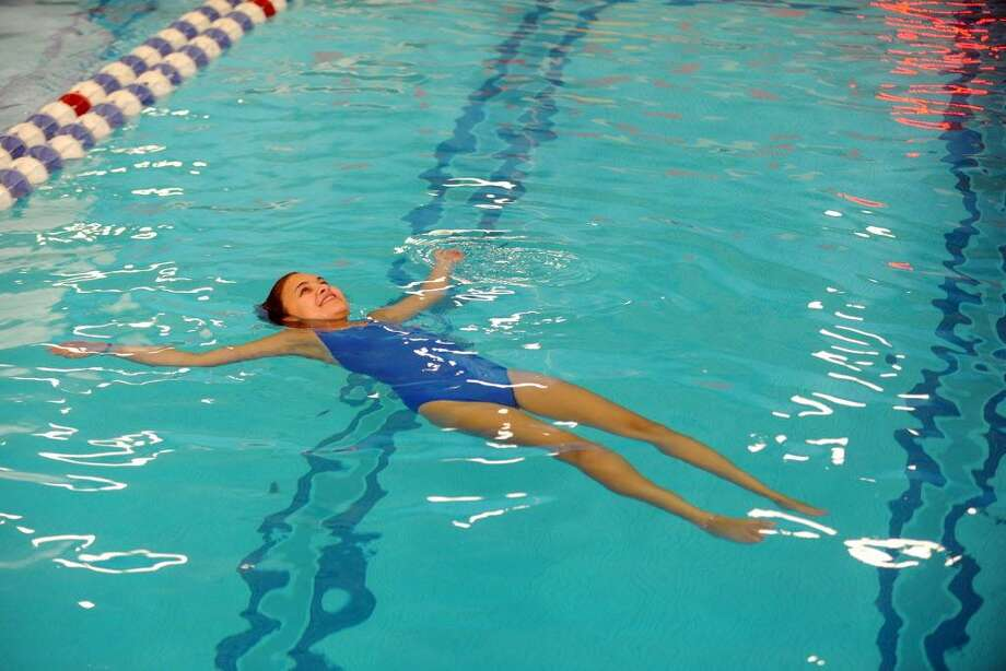 Swim instructor Tehillah Wasserman, 16, floats on her back while teaching pool safety at the ZAC Camp inside the YMCA in Stamford, Conn. on Tuesday, August 16, 2016. The ZAC Camp is named after Zachary Archer Cohen, the 6-year-old boy Greenwich boy who died after being trapped by a swimming pool drain in 2007. Photo: Michael Cummo / Hearst Connecticut Media / Stamford Advocate