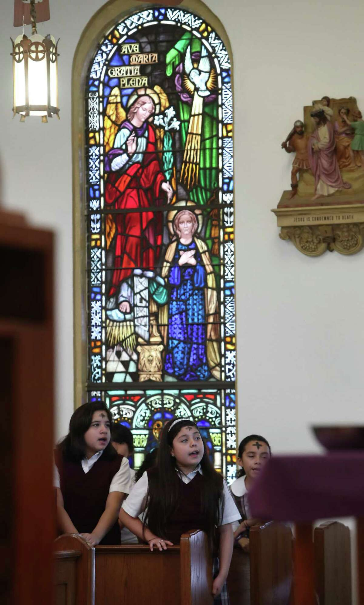 """Our Lady of Guadalupe school sing after receiving ashes during Ash Wednesday Mass, Wednesday, March 1, 2017, in Houston. Catholics mark the beginning of Lent with Ash Wednesday. Throughout the day, thousands will attend Masses and Services during which they will receive ashes across their foreheads in a ceremony known as the ?'imposition?"""" of ashes. The ashes symbolize penance and are a reminder of our mortality."""