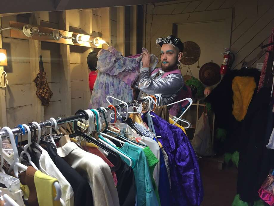 A customer makes a find among Thrillpeddlers' costume collection. Photo: Beth Spotswood
