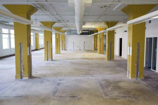 "Cubicles have been removed on the second floor of the Burns Building on Houston Street. Developer David Adelman plans to renovate the space into ""creative"" office space with open floor plans."