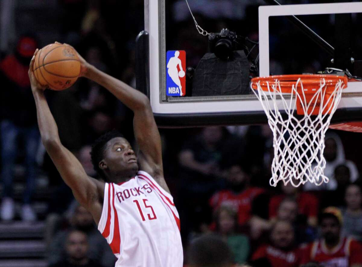 Houston Rockets center Clint Capela (15) catches a Houston Rockets guard James Harden (13) pass for a dunk during the Rockets game against the Boston Celtics at Toyota Center, Monday, Dec. 5, 2016, in Houston. ( Mark Mulligan / Houston Chronicle )