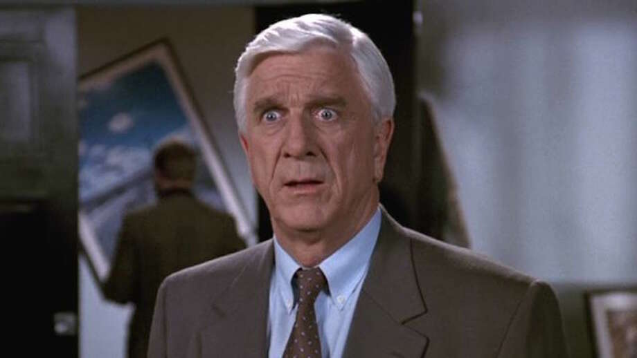 """#29. """"The Naked Gun""""Smart Rating: 90.89Year: 1988Genre: Comedy, ActionStarring: Leslie Nielsen, George Kennedy, Priscilla PresleyFrank Drebin (Leslie Nielsen), a rather clueless police detective, tries to foil a plot to turn innocent people into assassins through mind control. After his partner, Norberg (O.J. Simpson), is shot, Frank sets out to find the culprit, leading him to business tycoon Vincent Ludwig (Ricardo Montalban). However, Frank has no evidence until he meets Jane Spencer (Priscilla Presley), Ludwig's assistant. She knows nothing about Ludwig's devious plans, but falls for Frank and agrees to help him."""