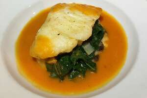 Fish of the day over spinach ($14.95)