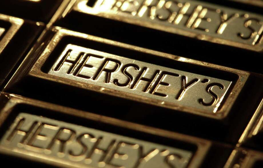 Hershey Co. expects to cut 15 percent of its global hourly workforce, primarily outside the United States. Photo: Associated Press /File Photo / A2011