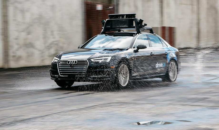 Drive.ai of Mountain View touts its cars ability to handle themselves in a downpour — typically a challenge for self-driving vehicles. Photo: Drive.ai