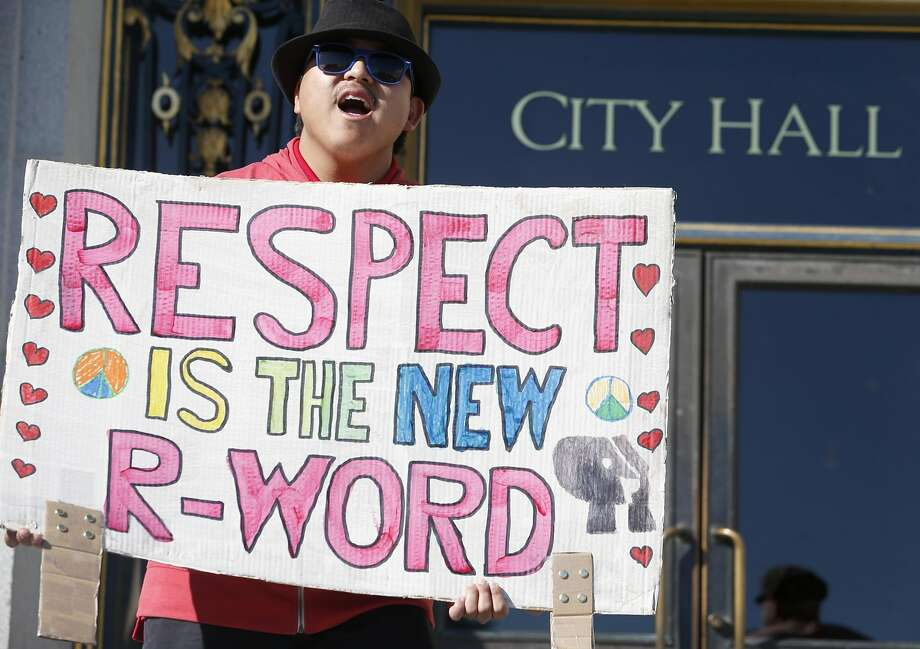"""Tommy Leong stands with other students from Access SFUSD in front of City Hall in San Francisco, Calif. on Wednesday, March 1, 2017. Special education students staged a rally on the steps of City Hall to discourage the use of the derogatory word """"retard"""" and to promote another R-word, """"respect,"""" instead. Photo: Paul Chinn, The Chronicle"""