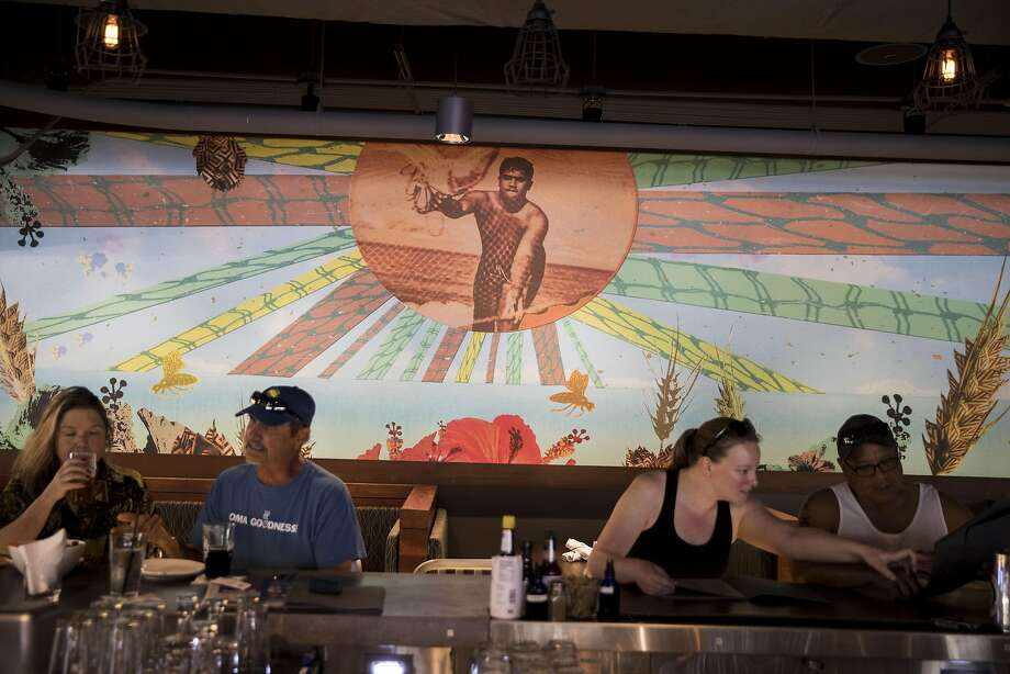 A mural by Big Island artist Margo Ray at the bar at Maui Brewing Co. in Honolulu, Hawaii. Photo: Kent Nishimura, Special To The Chronicle