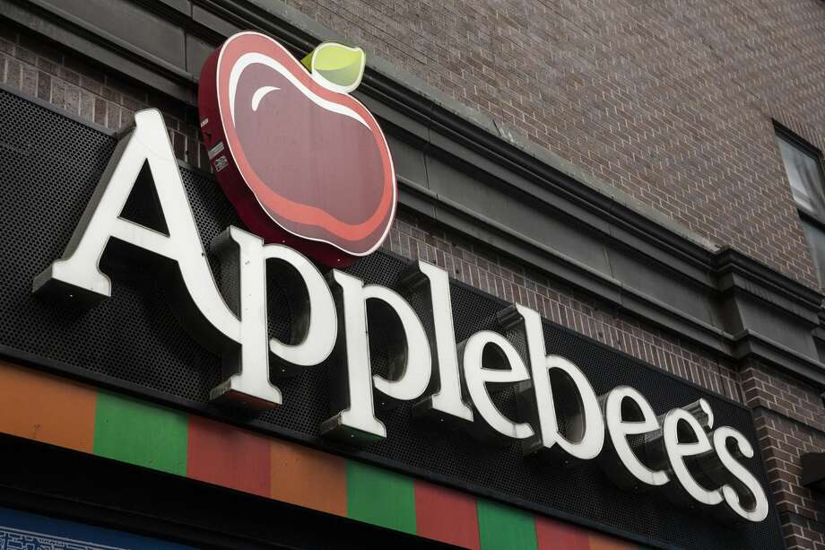 NEW YORK, NY - DECEMBER 01:  An Applebees restaurant is seen on December 1, 2015 in New York City. A new sodium warning that includes the logo of a salt shaker printed in menus is the result of a city-wide law effecting restaurants with 15 or more locations and lets consumers know that an item has 2,300 milligrams of sodium or more in it. Restuarants must have the logo on their menu starting today.  (Photo by Andrew Burton/Getty Images) Photo: Andrew Burton/Getty Images