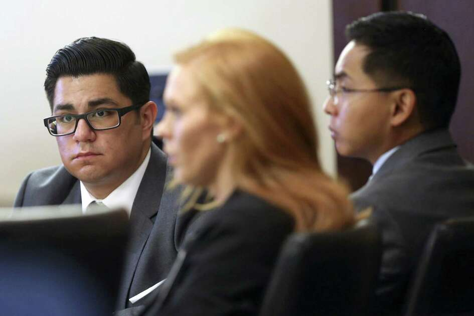 Former San Antonio Police officers Alejandro Chapa, left and Emmanuel Galindo, right. listen to testimony Wednesday, March 1, 2017 with one of their attorneys, Leah Cutter. The officers are on trial for charges of compelling prostitution, official oppression and aggravated sexual assault in 2015. Chapa and Galindo are accused of recruiting and duping women into having sex with them.