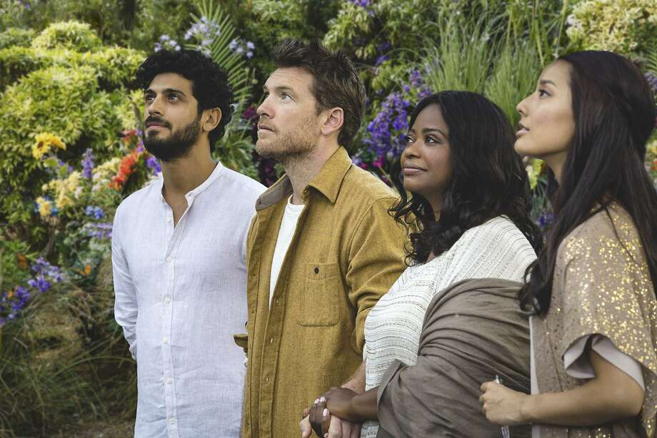 "Sam Worthington (second from left) plays a father who speaks with God in the religious drama ""The Shack."" Photo: Summit Entertainment"