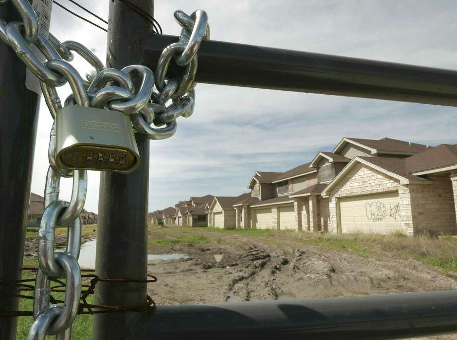 Tundra Town Home Village, an ill-fated South Side development, stands in dilapidated condition at 18495 Highway 16 South on Wednesday, March 1, 2017. The developer, Mauro T. Padilla, was imprisoned for defrauding First National Bank of Edinburg. County records show that many of the buildings at the site have been sold to a Dallas buyer. Photo: Billy Calzada, Staff / San Antonio Express-News / San Antonio Express-News