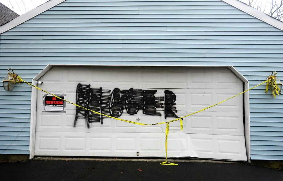Paint was apparently sprayed over a racial slur painted on a High Clear Dr. house was covered in a second act of vandalism in Stamford, Conn. on Wednesday, March 1, 2017. Photo: Michael Cummo / Hearst Connecticut Media / Stamford Advocate