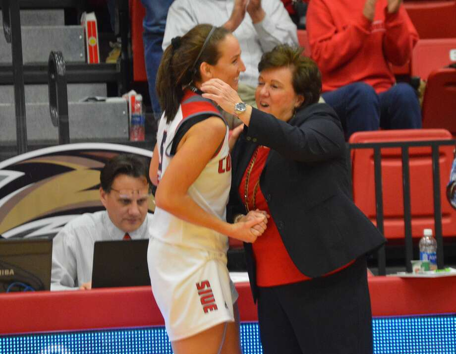 SIUE senior Cassidy Sherman, left, is congratulated by coach Paula Buscher after coming off the court during Saturday's game against Eastern Illinois at the Vadalabene Center.