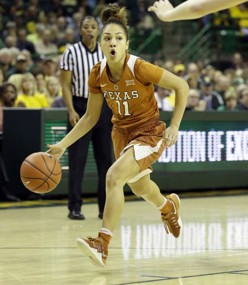 Texas guard Brooke McCarty (11) dribbles during the second half of an NCAA college basketball game against Baylor in Waco, Texas, Monday, Feb. 6, 2017. (AP Photo/LM Otero) Photo: LM Otero/Associated Press