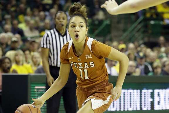 Texas guard Brooke McCarty (11) dribbles during the second half of an NCAA college basketball game against Baylor in Waco, Texas, Monday, Feb. 6, 2017. (AP Photo/LM Otero)