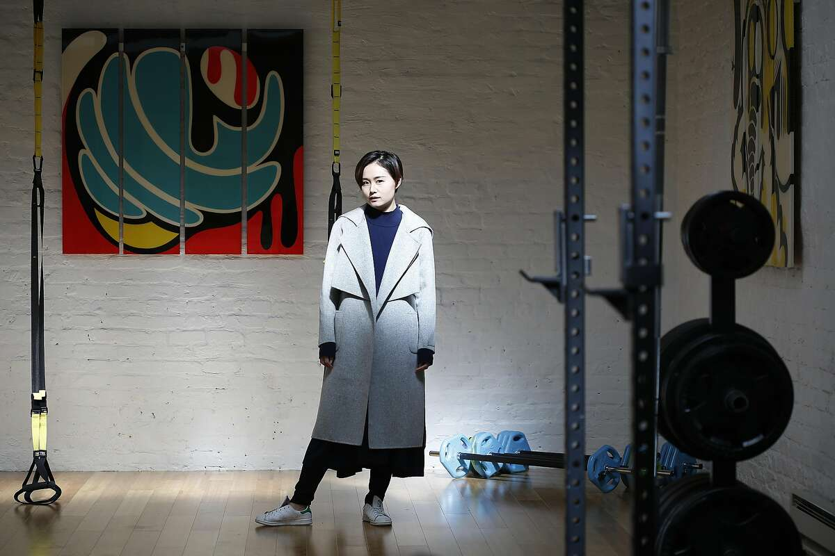 Mute fashion designer Joanne Lu shows her coat on Tuesday, February 28, 2017, in San Francisco, Calif.