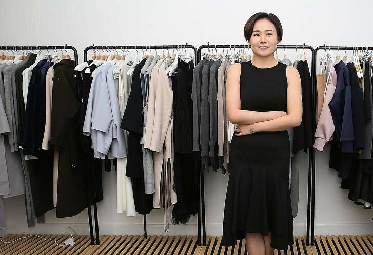 Mute fashion designer Joanne Lu shows her clothes in her studio on Tuesday, February 28, 2017, in San Francisco, Calif.