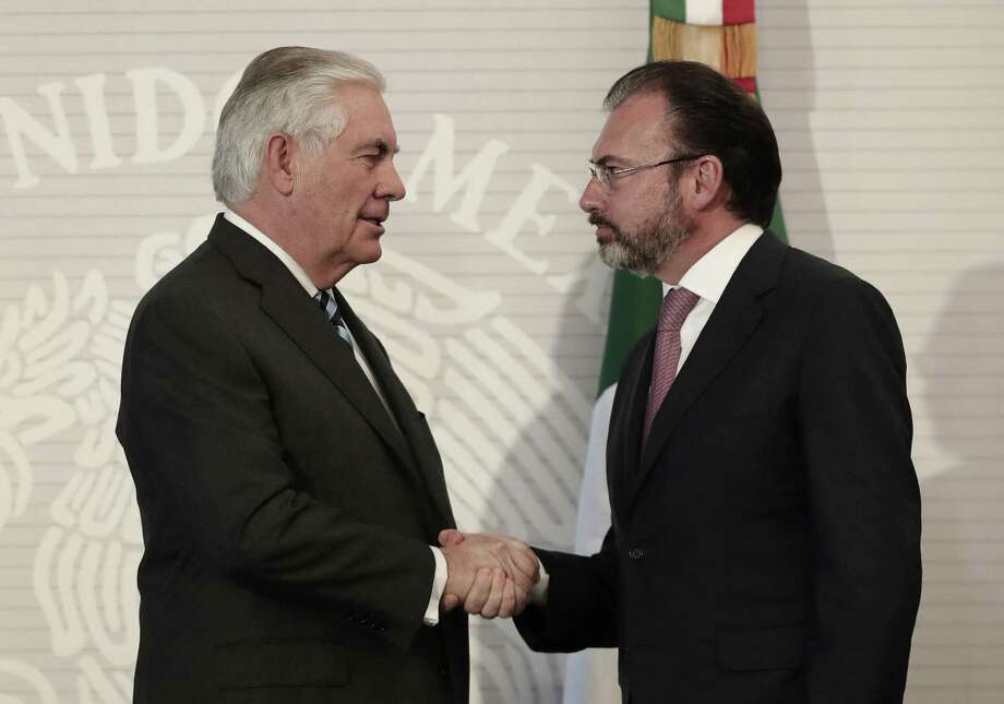 U.S. Secretary of State Rex Tillerson, left, shakes hands with Mexican Foreign Relations Secretary Luis Videgaray in Mexico City. A reader says Tillerson and other officials will be forced to put out fires ignited by President Trump. Photo: Rebecca Blackwell /Associated Press / Copyright 2017 The Associated Press. All rights reserved.