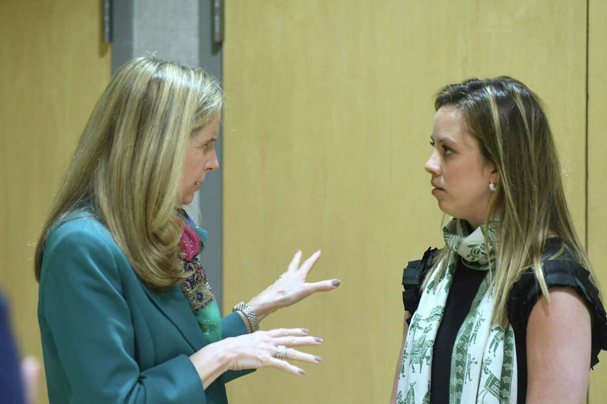 Molly King, Greenwich Academy's Head of School, speaks with Jessica Perkal, right, Director of Partnerships for the NYC and Boston regions of the One Love Foundation, as the YWCA Greenwich hosts a viewing of the film