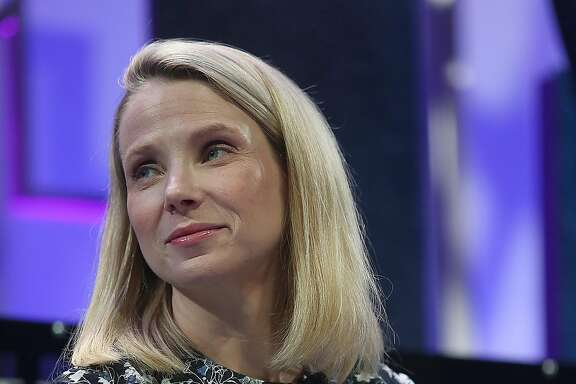 Yahoo CEO Marissa Mayer speaks with Salesforce chairman and CEO Marc Benioff at the Fortune Global Forum conference in San Francisco, Calif., on Tuesday, November 3, 2015.