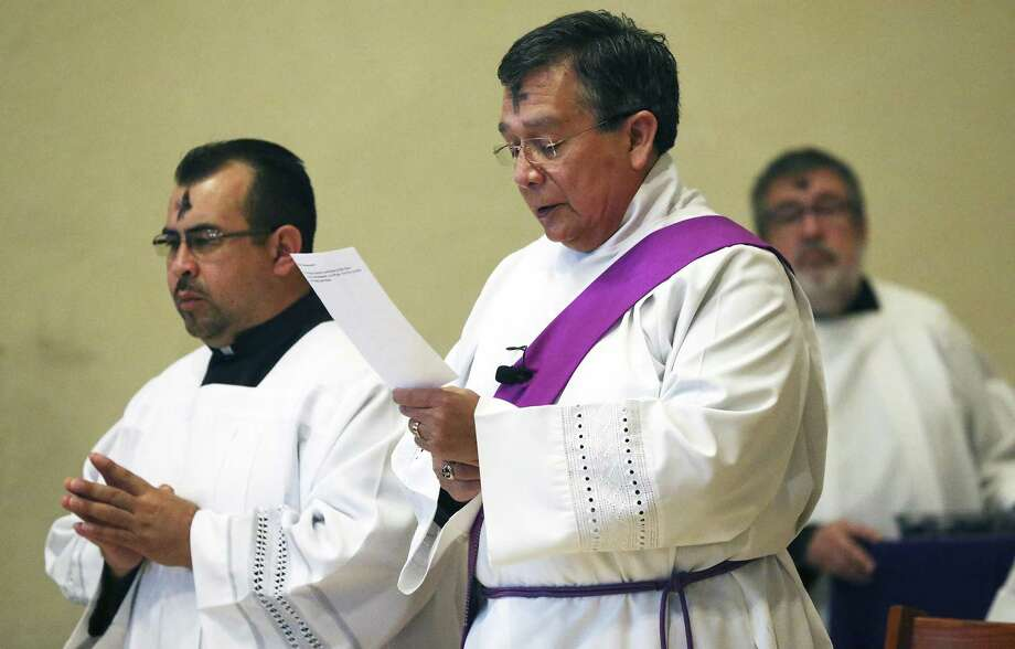 Deacon Julio Garcia recites the liturgy with seminarian Juan Robles before the applying of the ashes at San Fernando Cathedral on March 1, 2017. Photo: Tom Reel, Staff / San Antonio Express-News / 2017 SAN ANTONIO EXPRESS-NEWS