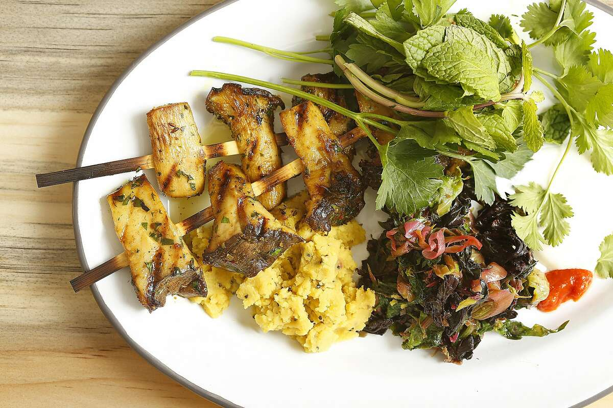 Grilled king trumpet mushrooms with red lentils, greens with green garlic, and pickled chiles at the Kebabery in Oakland.
