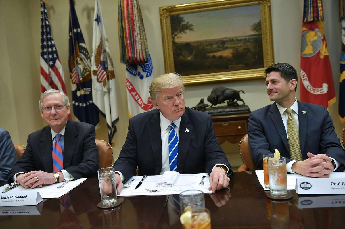 US President Donald Trump is seated for a a lunch with Republican Party House and Senate leadership, including Senate Majority Leader Mitch McConnell (L) and House Speaker Paul Ryan, in the Roosevelt Room of the White House in Washington, DC on March 1, 2017. / AFP PHOTO / Mandel NganMANDEL NGAN/AFP/Getty Images
