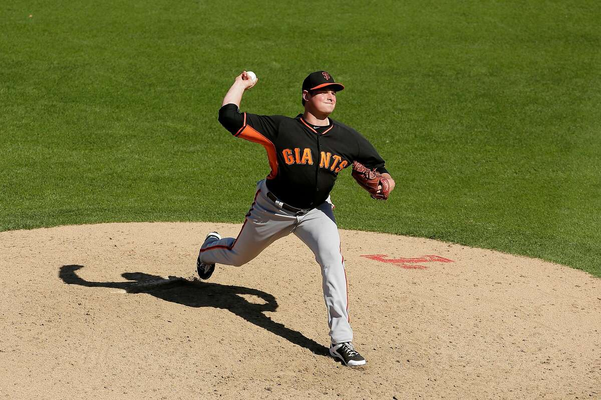 Giants relief pitcher Kyle Crick throws during the fifth inning of a spring training baseball game against the Rangers.