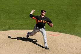 San Francisco Giants relief pitcher Kyle Crick throws during the fifth inning of a spring training baseball game against the Texas Rangers  Friday, March 6, 2015, in Surprise, Ariz. (AP Photo/Charlie Riedel)