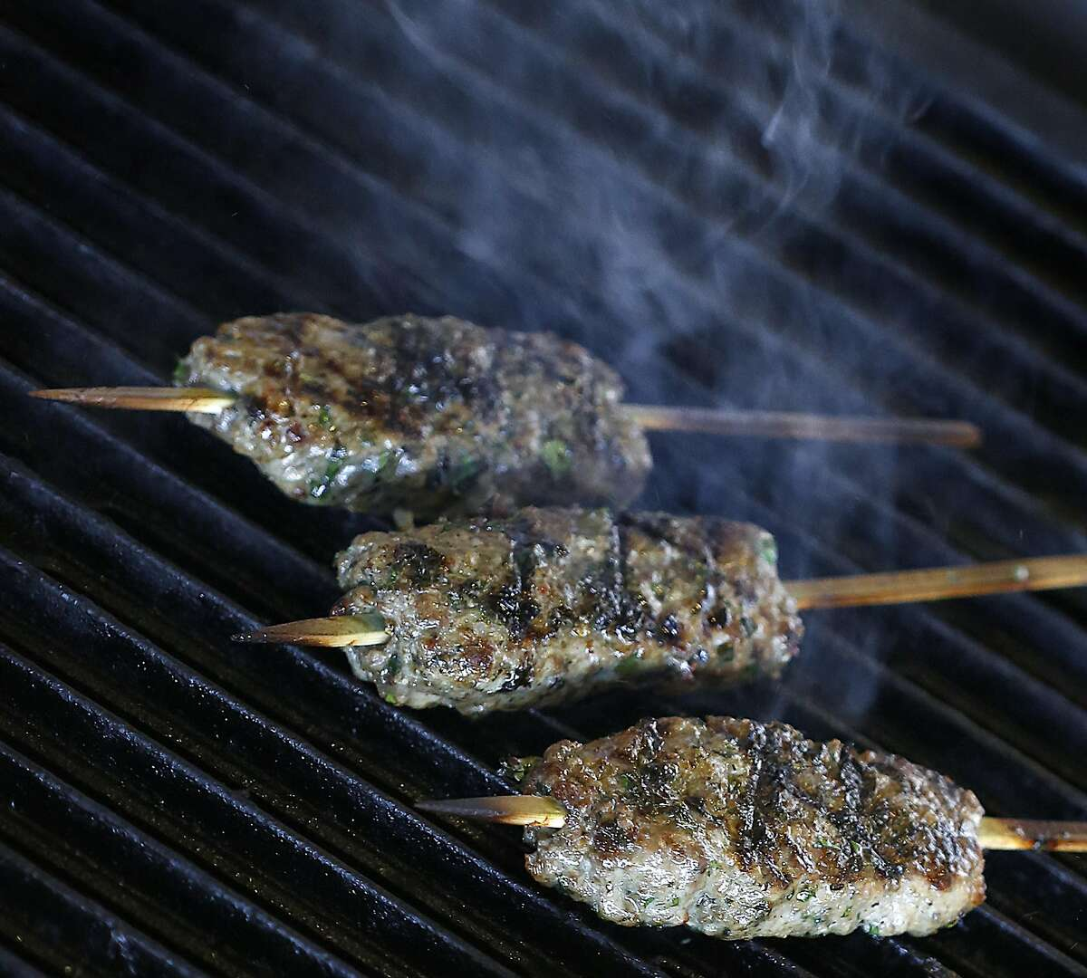 Lamb kebabs on the grill at the Kebabery on Tuesday, February 28, 2017, in Oakland, Calif.