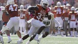 Texas running back D'Onta Foreman runs for a 37-yard touchdown against Baylor during the first half on Oct. 29, 2016, in Austin.