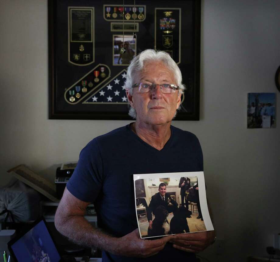 William Owens, clutching a photo of son Ryan, the SEAL killed in a January commando raid, says the administration is wrong to say that anyone who questions the raid does his son a disservice. (Emily Michot/Miami Herald/TNS) Photo: Emily Michot, MBR / Miami Herald
