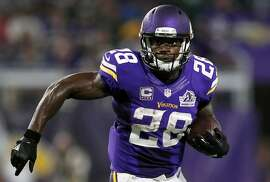 FILE - In this Sept. 18, 2016, file photo, Minnesota Vikings running back Adrian Peterson carries the ball during the first half of an NFL football game against the Green Bay Packers in Minneapolis. The Vikings on Tuesday, Feb. 28, 2017. have declined to exercise their option for next season on Peterson�s contract. This makes the franchise�s all-time leading rusher an unrestricted free agent when the market opens next week. (AP Photo/Andy Clayton-King, File)