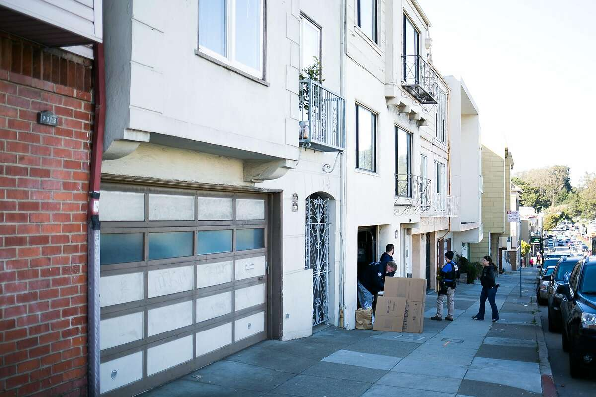 Homeland Security Investigation agents investigate a residence on 19th Avenue between Irving Street and Judah Street in San Francisco, Calif. Wednesday, March 1, 2017.