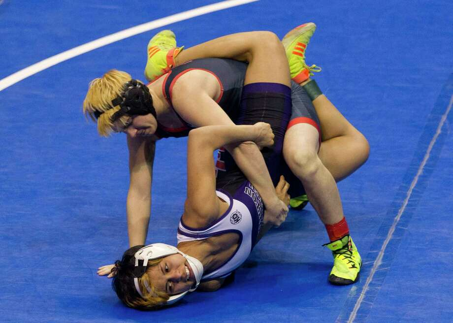 Euless Trinity junior Mack Beggs, top, drives Morton Ranch's Chelsea Sanchez  into the mat during the Class 6A girls 110-pound championship final. Photo: Jason Fochtman, Staff Photographer / © 2017 Houston Chronicle