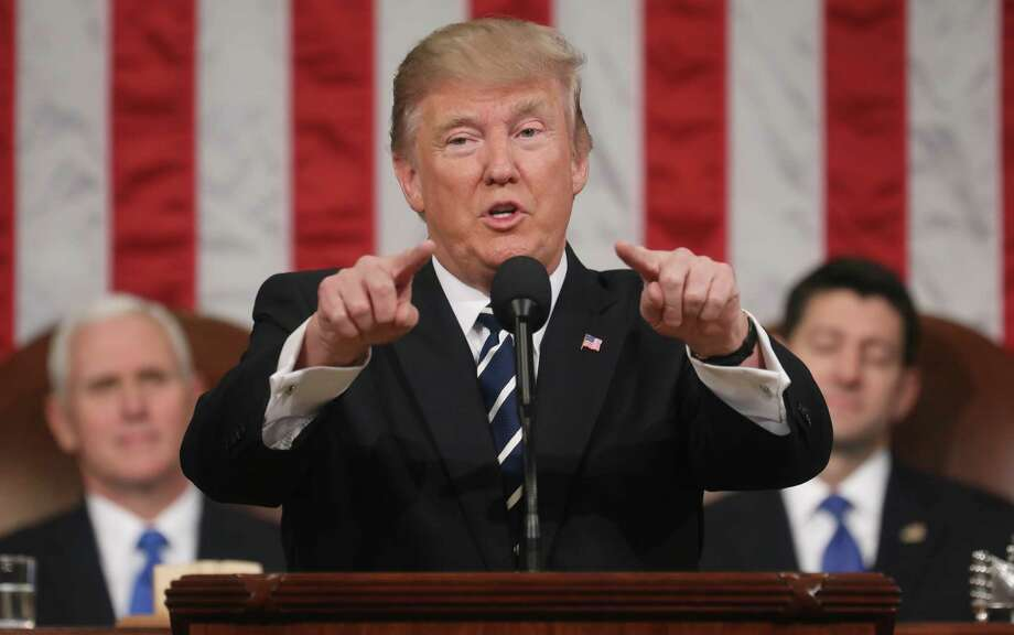 President Donald Trump gestures Tuesday night while speaking during a joint session of Congress in Washington, D.C. Photo: Jim Lo Scalzo / © 2017 Bloomberg Finance LP