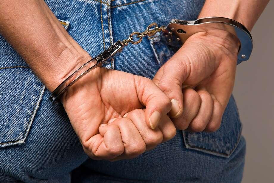 Handcuffs - symbol for crime / 6688222