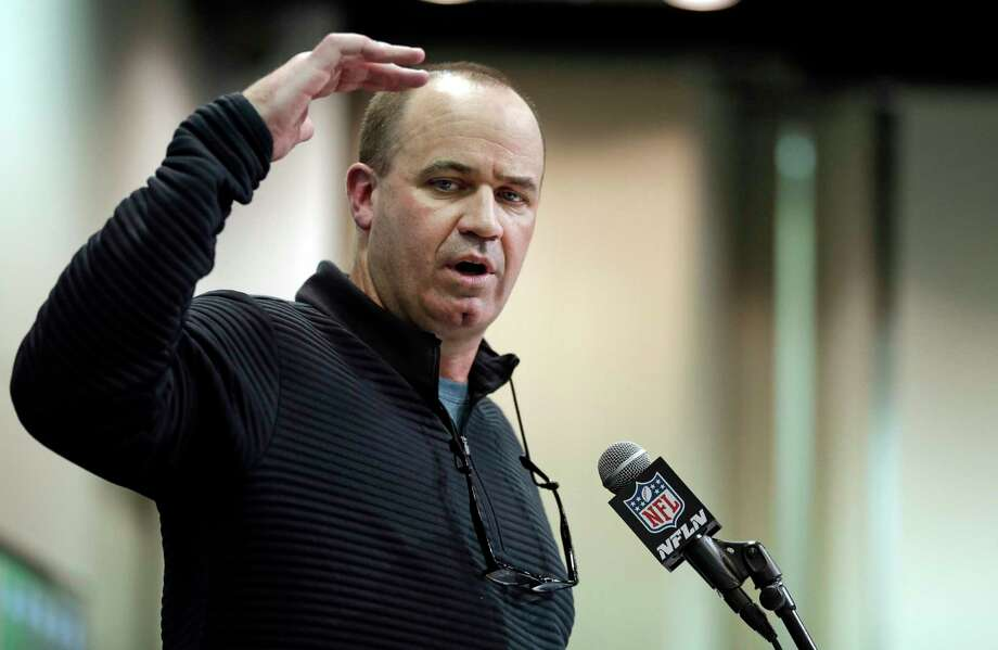 Texans coach Bill O'Brien didn't say he's had it up to here with QB talk, but he wasn't saying much at the NFL combine. Photo: Michael Conroy, STF / Copyright 2017 The Associated Press. All rights reserved.