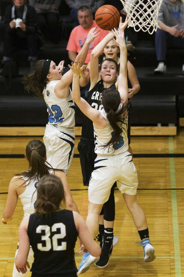 THEOPHIL SYSLO | For the Daily News Bullock Creek's Haley Jaster attempts the rebound while being defended by Meridian's Kassidy Zmikly and Madisyn Wirth in a game at Bullock Creek High School on Wednesday. Photo: Theophil Syslo For The Daily News
