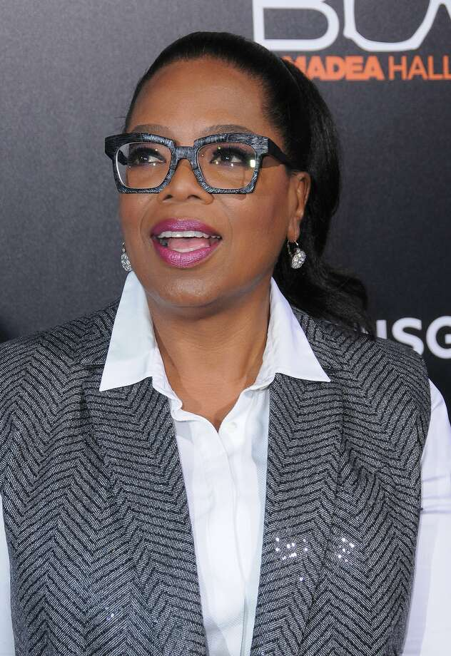 Oprah Winfrey sold her Chicago condo to an LLC last year, which has now sold a portion of the unit to the CEO of United, Oscar Munoz.  Photo: Birdie Thompson/AdMedia, TNS