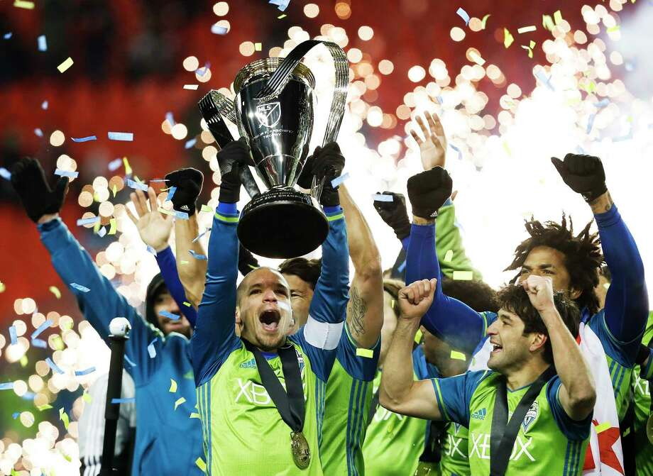 In this Dec. 10, 2016, file photo, Seattle Sounders midfielder Osvaldo Alonso, front left, hoists soccer's MLS Cup with teammates after defeating Toronto FC in the playoff game. Launched with 10 teams in 1996, MLS has plans to expand to 28 teams in coming years. Photo: Mark Blinch, SUB / The Canadian Press