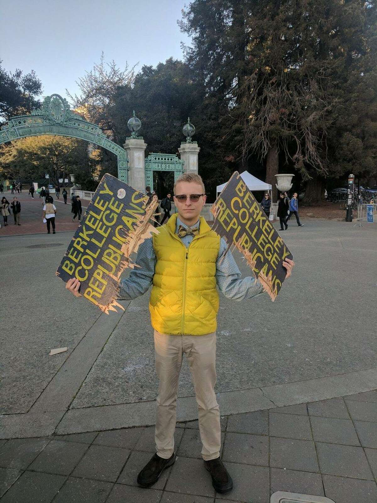 Troy Worden, a member of the Berkeley College Republicans and third year student, displays one of the group's signs that was destroyed on campus Tuesday evening.