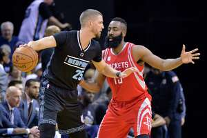 Memphis Grizzlies forward Chandler Parsons (25) controls the ball against Houston Rockets guard James Harden (13) in the first half of an NBA basketball game Saturday, Jan. 21, 2017, in Memphis, Tenn. (AP Photo/Brandon Dill)