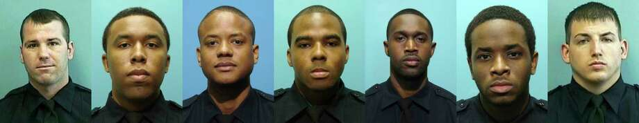 These undated photos provided by the Baltimore Police Department show, from left, Daniel Hersl, Evodio Hendrix, Jemell Rayam, Marcus Taylor, Maurice Ward, Momodu Gando and Wayne Jenkins, the seven police officers who are facing charges of robbery, extortion and overtime fraud, and are accused of stealing money and drugs from victims, some of whom had not committed crimes. (Baltimore Police Department via AP) Photo: Uncredited, HOGP / Public Domain