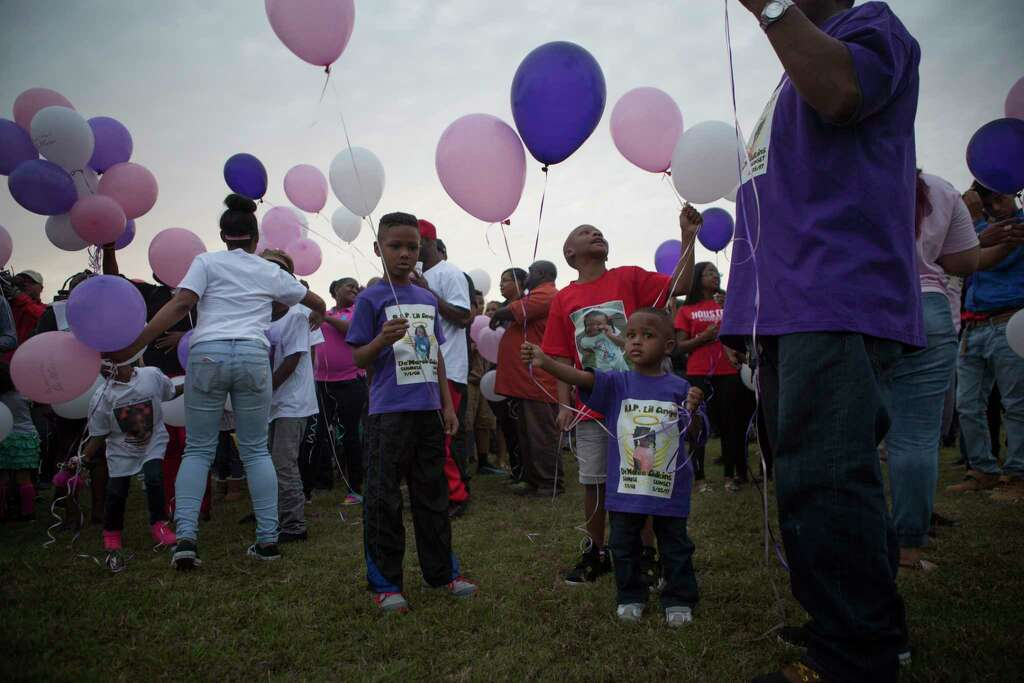 Family and community members gather for a balloon release in memory of 8-year-old De'Maree Adkins Wednesday, March 1, 2017, in Houston. De'Maree was killed in a shooting at the intersection of W. Fuqua and Beltway 8 early last Saturday morning. Photo: Mark Mulligan, Houston Chronicle / © 2017 Houston Chronicle