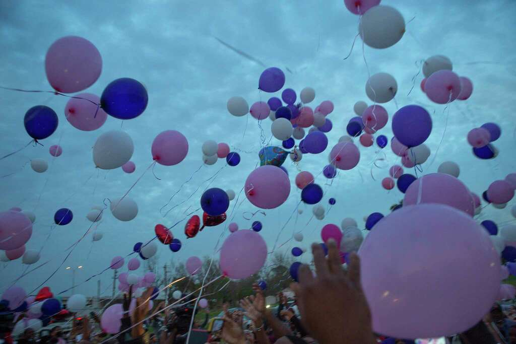 Balloons float into the sky during a balloon release in memory of 8-year-old De'Maree Adkins Wednesday, March 1, 2017, in Houston. De'Maree was killed in an apparent drive-by shooting at the intersection of W. Fuqua and Beltway 8 early last Saturday morning. Photo: Mark Mulligan, Houston Chronicle / © 2017 Houston Chronicle