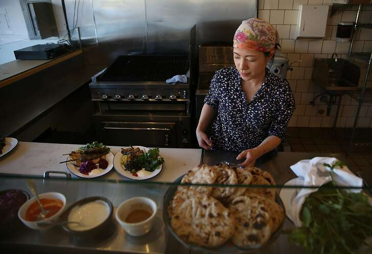 Chef Traci Matsumoto-Esteban makes plates of kebabs at the Kebabery on Tuesday, February 28, 2017, in Oakland, Calif.