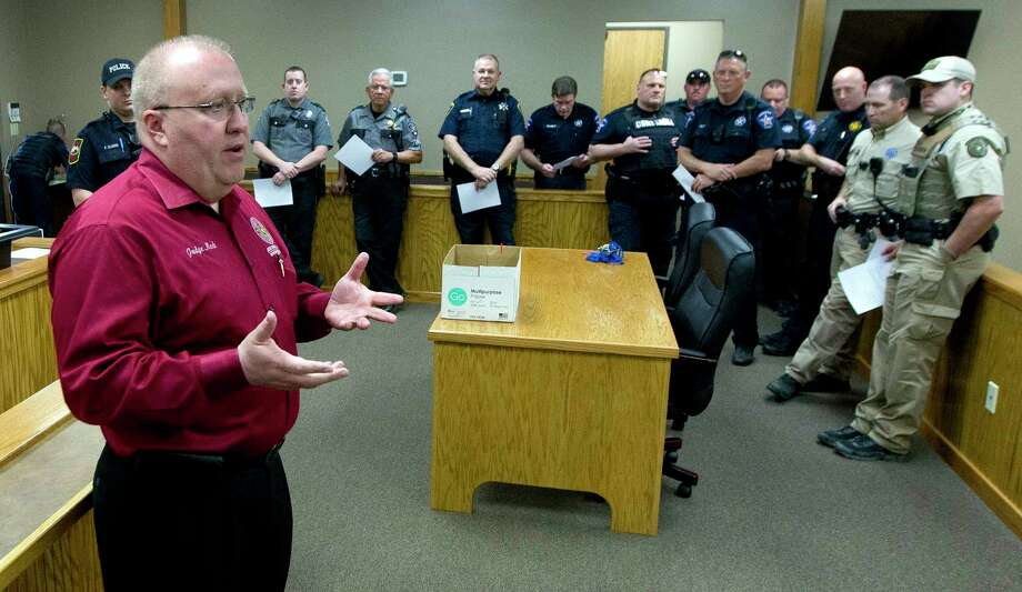Montgomery County Precinct 1 Justice of the Peace Wayne Mack speaks before the start of the statewide Great Texas Warrant Roundup Wednesday in Willis.  Law enforcement agencies from around Montgomery County went through out the county looking for those with outstanding Class C misdemeanor warrants. Photo: Jason Fochtman, Staff Photographer / © 2017 Houston Chronicle