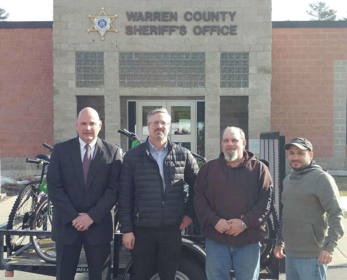 Left to right: Warren County Undersheriff C. Shawn Lamouree with Christopher Collins, Kristel Kannan and Michael Romanowski of Freedom Machine.